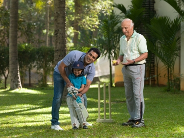 Grandfather, Father And Son Playing Cricket