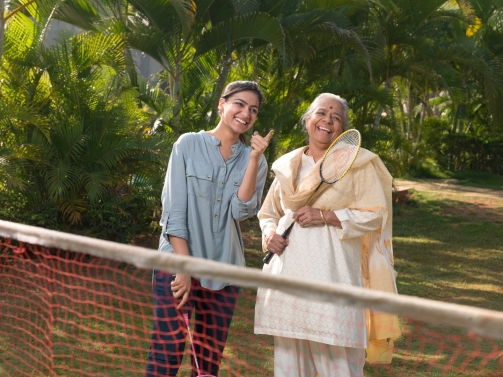 Grandmother And Mother Playing Badminton