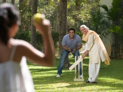 Grandmother, Father and Daughter Playing Cricket